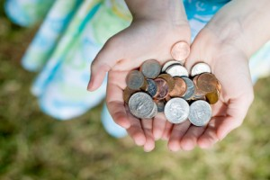 Girl holding coins